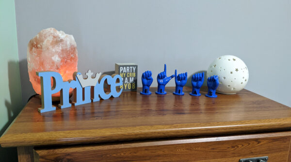 """Letters """"ELIAS"""" in blue with black letters on a dresser in nursery"""