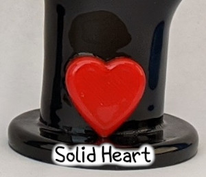 detail photo of red solid heart on black i love you hand